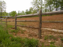 4 rails of hemlock split rail fence installed on locust posts